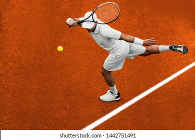 Tennis player focused in ready position.He is on tennis court.