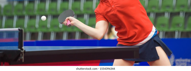 Tennis player hits a racket on a tennis ball