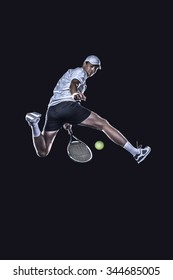 Tennis player jumping for the ball from behind isolated on black background