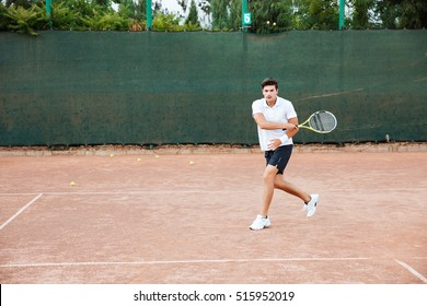 Tennis player man playing on court