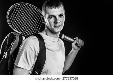 Tennis player on black background. Studio shot