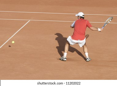 Tennis player on hard court in action