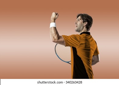Tennis player with a orange shirt, celebrating on a orange background.