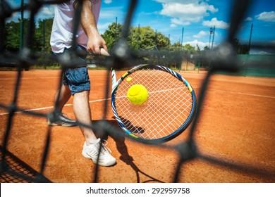 Tennis player playing a match