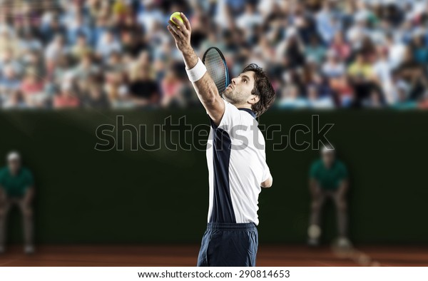 Tennis player playing on a clay tennis court.