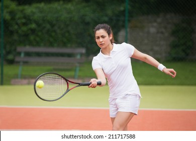 Tennis player playing on the court on a sunny day