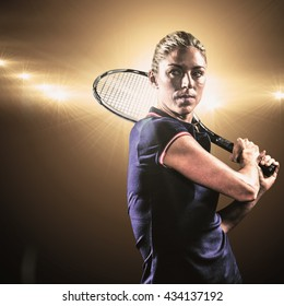 Tennis player playing tennis with a racket against spotlight