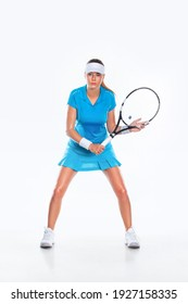 Tennis player with racket in blue costume. Woman athlete playing isolated on white background.