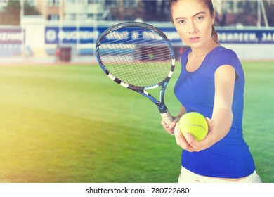 Tennis player with racquet