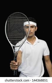 Tennis player showing a tennis racket