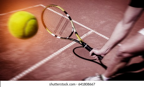 Tennis player stretches to play ball
