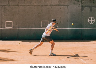 tennis player training outdoors