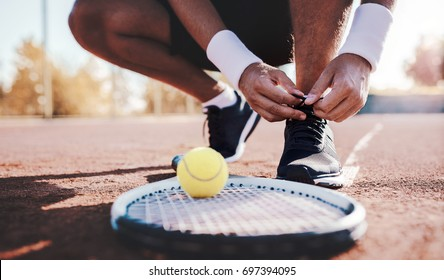 Tennis player tying sport shoes. Sport, recreation concept