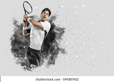 Tennis Player with a white uniform coming out of a blast of smoke .