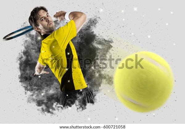 Tennis Player with a yellow uniform coming out of a blast of smoke .