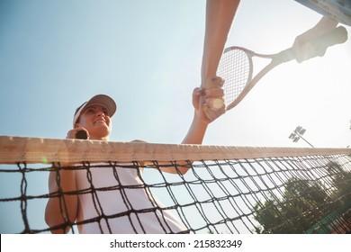 Tennis Players Finish A Match