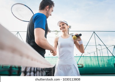 Tennis players shaking hand after match congratulate the winner