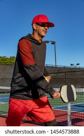 Tennis pro teaches the proper way to hold the paddle