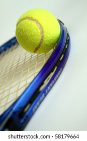A tennis racket and tennis ball