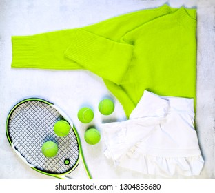 Tennis racket, ball and clothes on white background flat lay