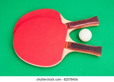tennis racket and a ball on a green background