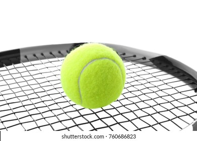Tennis racket and ball on white background, closeup