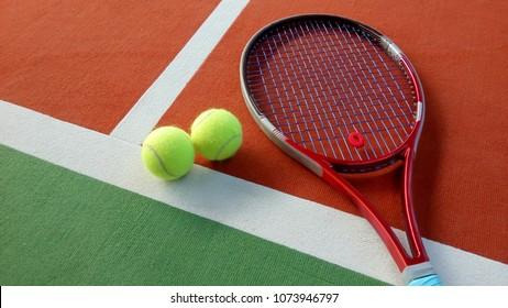 tennis racket with tennis balls in an indoor tennis center