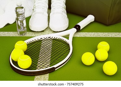 Tennis racket with balls and sneakers, water bottle, gym bag, towel on green court background. 3D illustration