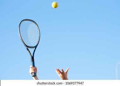 Tennis racket in hand and ball