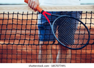 Tennis racket and tennis net on tennis court