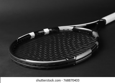 Tennis racket on dark background