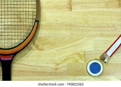 tennis racket retro on wood blackground