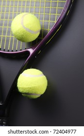 Tennis racquet with ball isolated on the background.