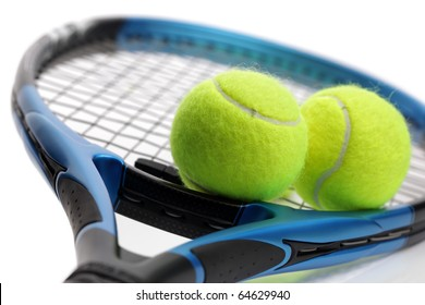 Tennis racquet and two balls on white background