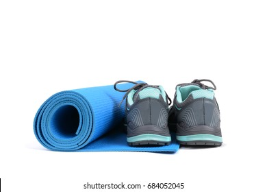 tennis shoes and yoga mat white background