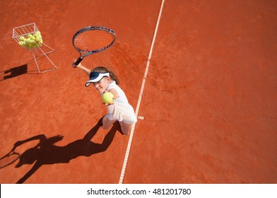 Tennis talent practicing services. Wide angle view from above, convenient copy space
