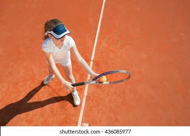 Tennis talent preparing to serve