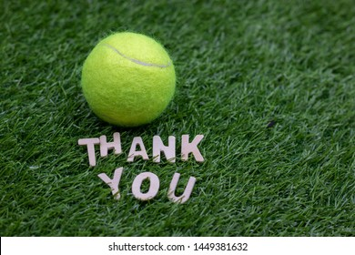 Tennis Thank you with tennis ball on green grass.