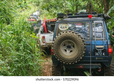 Tenom Sabah Malaysia - Oct 26, 2015 : Adventurer on 4X4 car during Borneo Safari Expedition in the jungle of Sabah Malaysian Borneo. Borneo jungle is popular tourism destination for outdoor adventure.