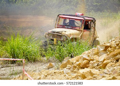 Tenom Sabah Malaysia - Oct 31, 2015 : Car enthusiast using modified four wheel drive vehicle in rough off road track in Sabah Borneo. Sabah Borneo is famous for 4x4 adventure tourism.