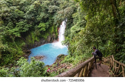 Tenorio National Park, Costa Rica - September 24 : Tour guide waiting for his group as they enjoy the waterfall at the base of the trail. September 24 2017, Tenorio National Park Costa Rica.