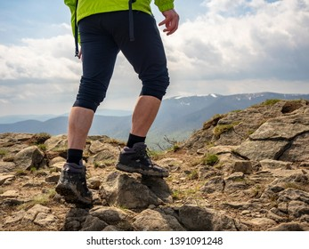 tense muscles of the traveler's legs on top of a mountain in the Bieszczady mountains