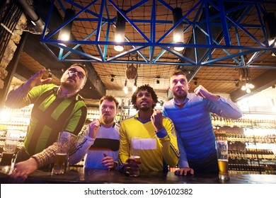Tense situation made soccer fans get off their chairs in a pub and lean toward a screen.