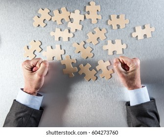 tensed businessman hands impatient to connect puzzle pieces for concept of teamwork and cooperation problem, managing company togetherness or oneness, above view