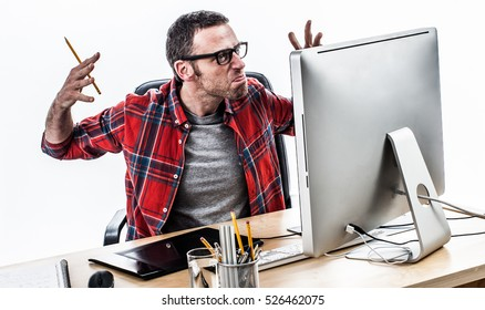 tensed middle aged casual man working with stress and exasperation, raising angry hands in front of his computer, white background, contrast effects