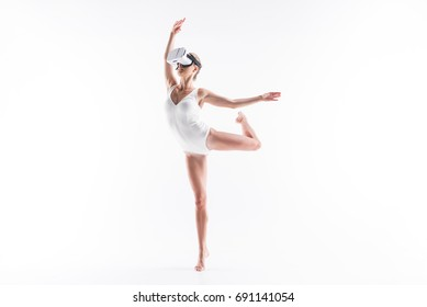 Tensed young sporty woman training choreography element using goggles