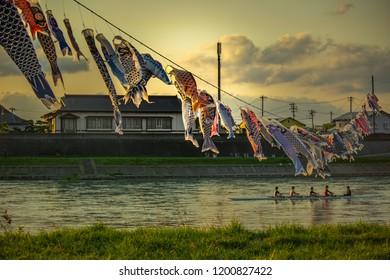 Tenshochi Park,Kitakami,Iwate,Tohoku,Japan on April 26,2018:Carp streamers (or koinobori) and rowing boat at Kitakami River.