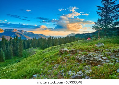 Tent in Alpine Meadow with Mountains