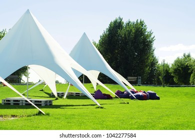 Tent awning Star, A white tent or marquee in a green field. star tent, outdoor activities, vents, beautiful awning for relaxation
