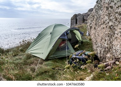 A tent camped on the Cornwall coast by the Celtic Sea